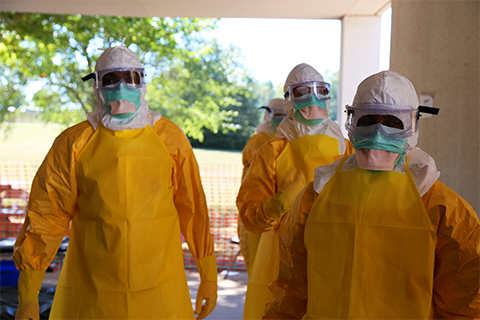 Health care workers wearing personal protective equipment